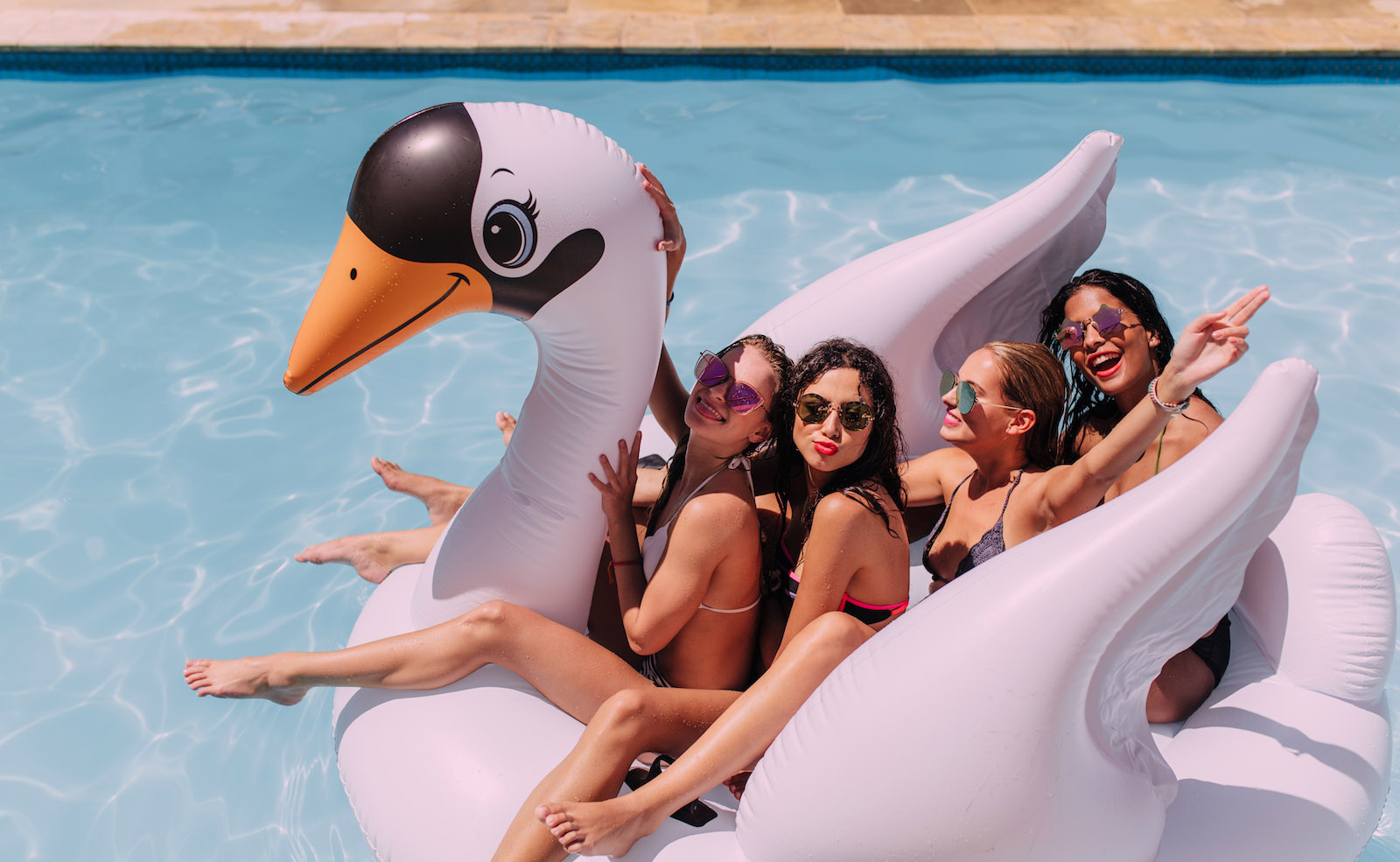 Girls partying in a pool